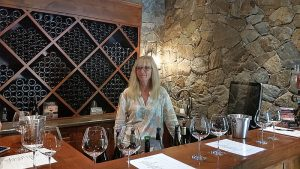 Debbie Woodward preparing to pour wines for us to taste at Privato Winery