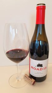 Road 13 Jackpot Syrah 2016 with wine in the glass