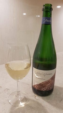 Blue Grouse Paula sparkling wine with wine in glass