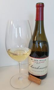 Black Hills Estate Winery Chardonnay 2017 with wine in glass