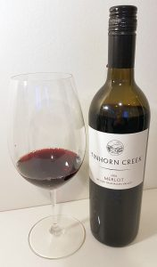 Tinhorn Creek Vineyards Merlot 2016 with wine in glass