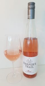 Harper's Trail Rose 2018 with wine in glass