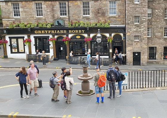 Greyfriars Bobbys pub with statue of Bobby out front