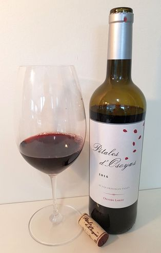 Osoyoos Larose Petales d'Osoyoos 2016 with wine in glass