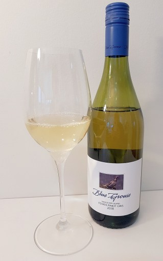 Blue Grouse Estate Pinot Noir 2018 with wine in glass