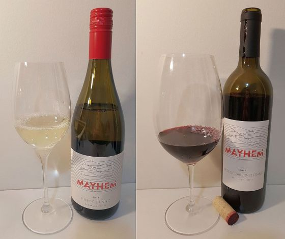 Mayhem Pinot Blanc 2018 and Merlot Cabernet Franc 2017 with wine in glass