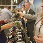People sampling French wine at VanWineFest 2020