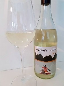 Gratitude by JAK's Pinot Blanc 2019 with wine in glass