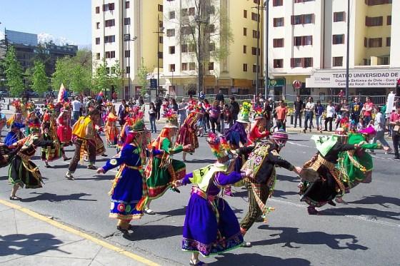 Costumed dancers parade in Santiago