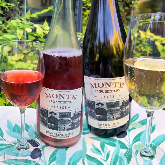 Monte Creek Ranch Sparkling 2019 and Sparkling Rosé 2019 with wines in glasses on the patio