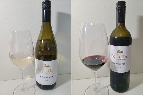Gold Hill Chardonnay 2019 and Cabernet Franc 2015 with wines in glasses