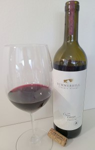 Summerhill Pyramid Winery Organic Syrah 2019 with wine in a glass
