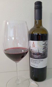 Seaside Pearl Farmgate Winery Landing Road Red Blend 2018 with wine in glass