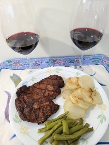 Grilled ribeye steak paired with Mt. Boucherie Estate Winery Merlot 2018 (L) and Reserve Syrah 2018 (R)