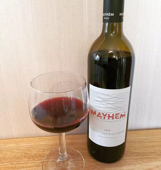 Mayhem Wines Merlot Cabernet Franc 2018 with wine in glass
