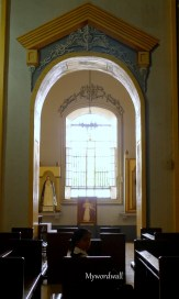 One of the many arcs leading to the side pews of San Sebastian Cathedral