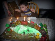 The train cake is such a favorite that it has appeared several times on the birthday table. This one went over a mountain on a lovely spring day.