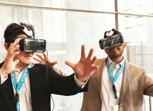 Level Up Village team members try out VR goggles at #GEF16.
