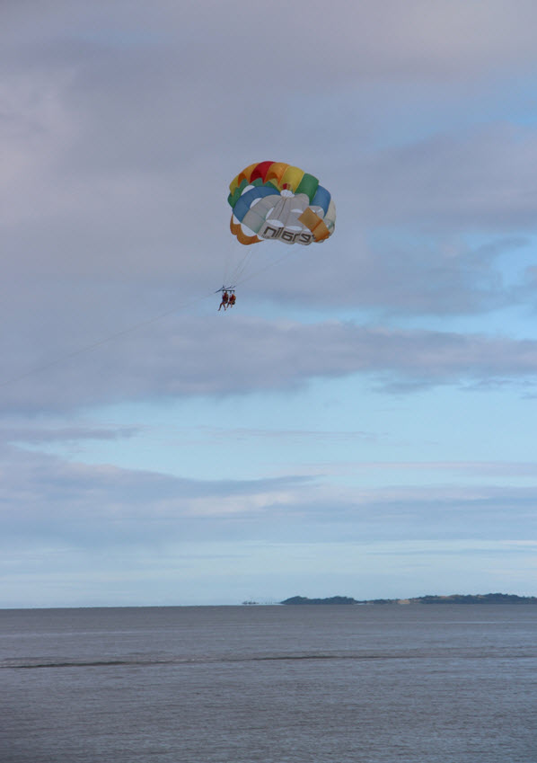 Parasailing off the coast at the Wyndham resort