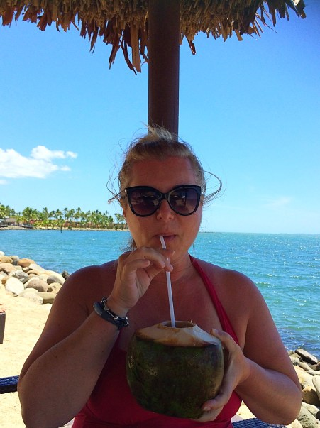 Drinking coconut water straight from the source.