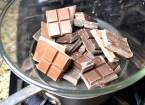 Melt chocolate over double boiler