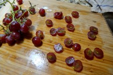 Cut each grape