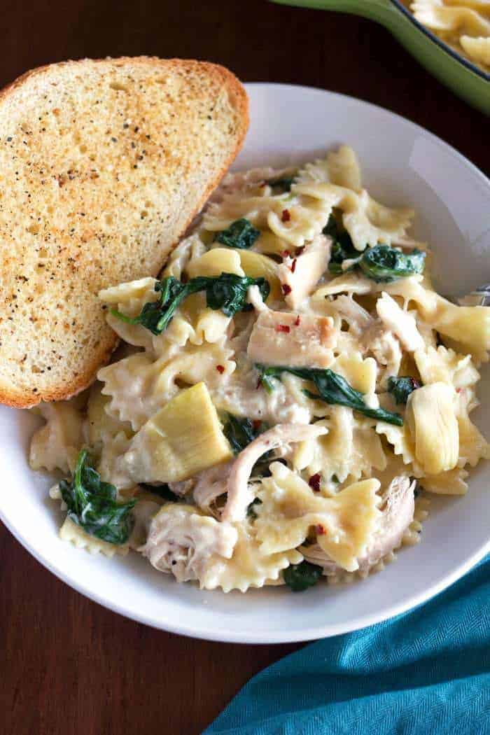 Creamy Spinach Artichoke Chicken Pasta is the perfect weeknight meal!