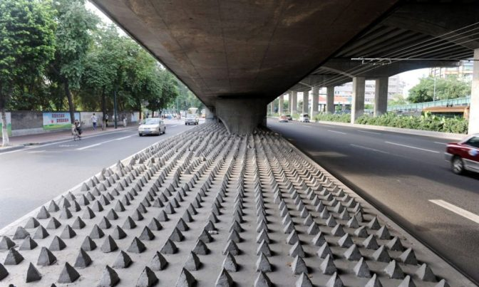 Concrete spikes under a road bridge in Guangzhou city, Guangdong, China. Photograph: Imaginechina/REX