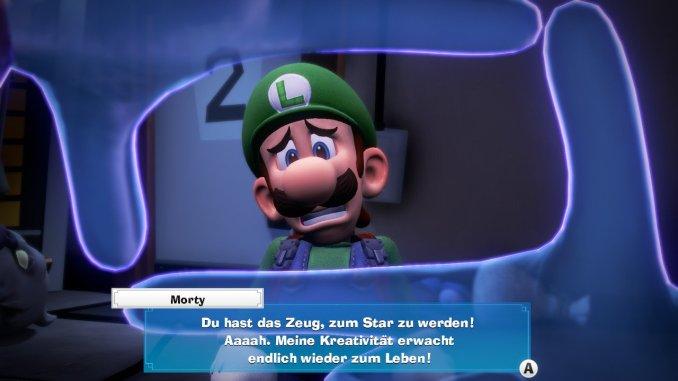 Das Foto zeigt einen verunsicherten Luigi in einem Finger-Rechteck eines Geister-Regisseurs, welcher sagt, dass Luigi das Zeug zum Star hat.