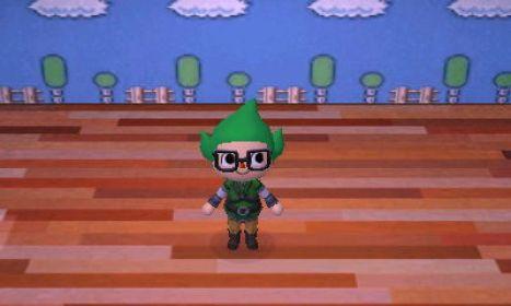 Das Bild zeigt einen Charakter aus Animal Crossing: New Leaf. Er trägt neben einer großen Brille eine grüne Mütze auf dem Kopf. Diesen Hut kennt man von Tingle.