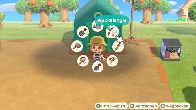 Das Bild zeigt einen wichtigen Teil von Animal Crossing: New Horizons. Man erkennt den Werkzeugring welcher um den Kopf des Avartas angeordnet ist. Acht Werkzeuge haben darin Platz.