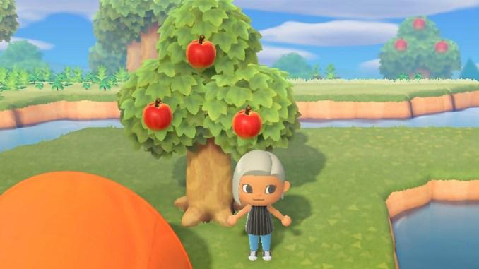 """Das Bild zeigt einen """"Animal Crossing: New Horizons""""-Charakter, welcher vor einem Apfelbaum steht."""
