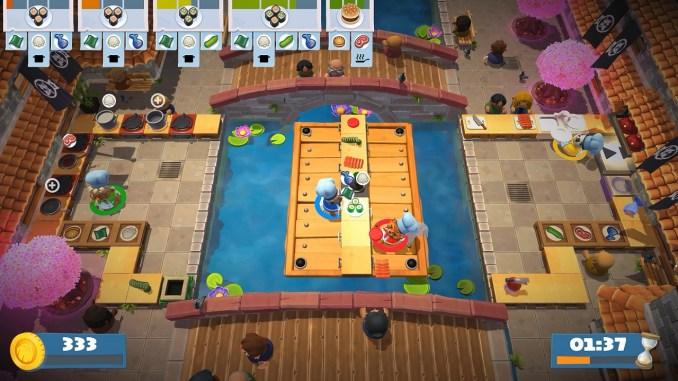 Das Bild zeigt eine Szene aus Overcooked! 2: Gourmet Edition. Man sieht vier Köche, welche versuchen, die perfekten Gerichte zu kochen.