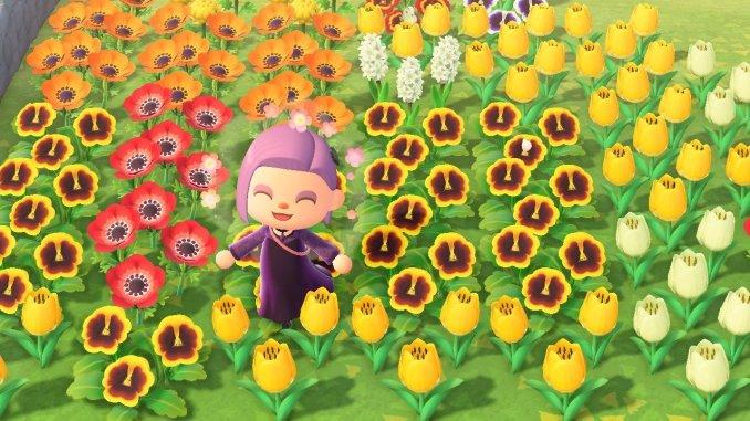 """Das Bild zeigt einen Charakter aus """"Animal Crossing: New Horizons"""", welcher in einem Meer aus Blumen steht. Man erkennt Veilchen, Tulpen, Hyazinthen und Cosmea."""