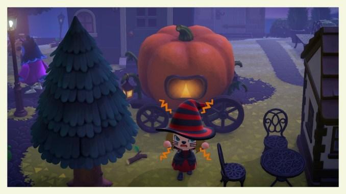 """Das Bild zeigt die Kürbiskutsche und eine besondere Emotion zu Halloween in """"Animal Crossing: New Horizons""""."""