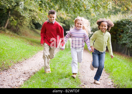 Three Kids Having Fun On The Beach In The Village Of ...