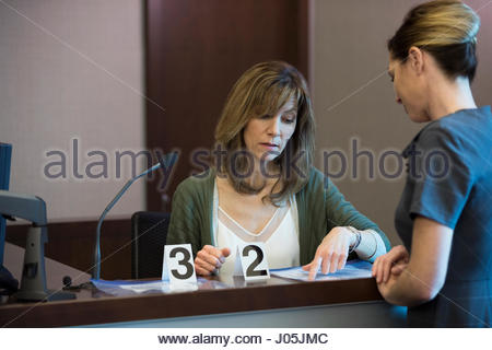 A lawyer questioning a witness Stock Photo, Royalty Free ...