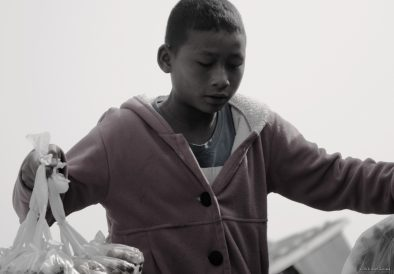 A young boy selling food on the boat to Bhamo