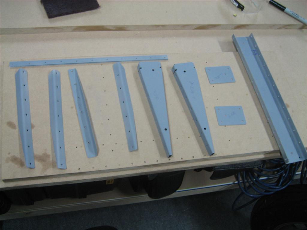 Stiffeners, doublers, trailing edge wedge, spar, and ribs ready to rivet.