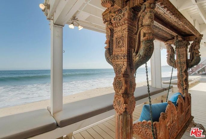 Carved wooden swing and built-in deck seating