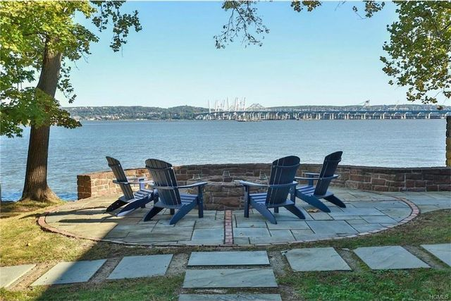 Waterfront fire pit of second largest home