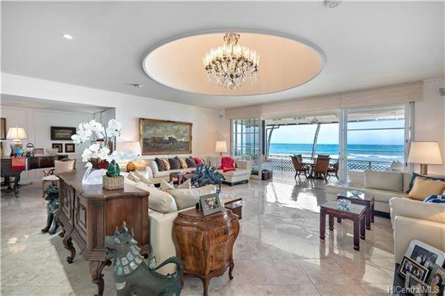 Living room with floor-to-ceiling glass doors