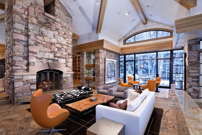 Living room with stacked-stone fireplace