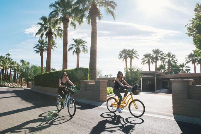 Paris Ebersviller and Rachel Sadowsky bike through the Vista Las Palmas neighborhood.
