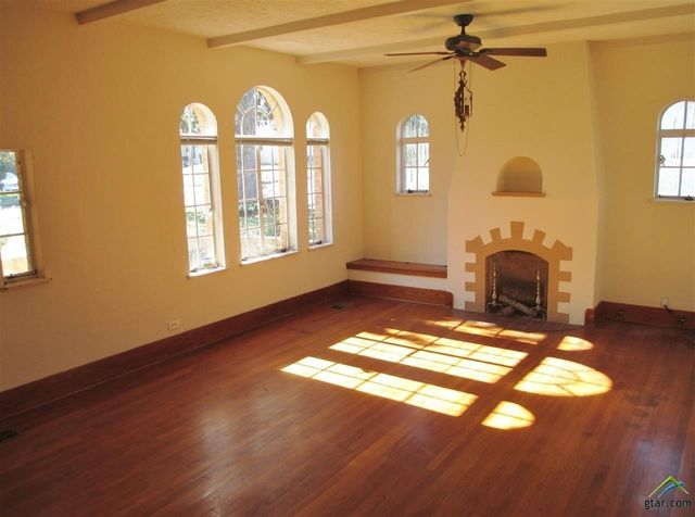 Living room with original curved windows