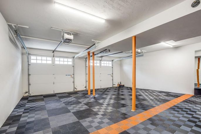 Two-car garage with custom flooring