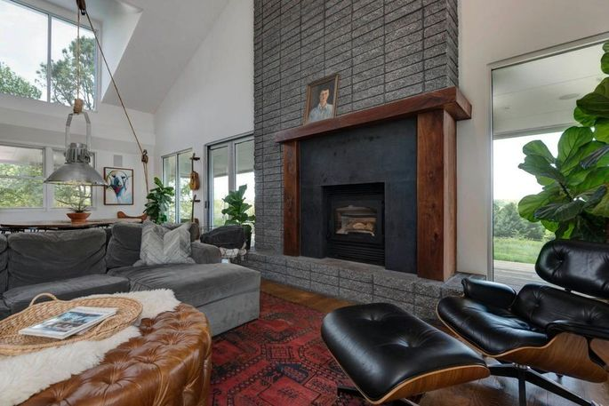 Dining and living space with fireplace