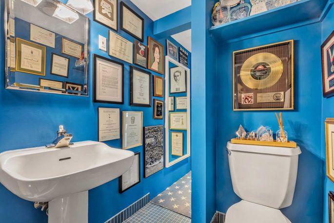Bathroom with Sarandon's awards