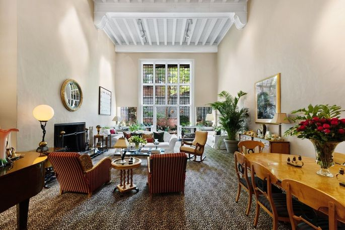 Living and dining space with 20-foot-high ceiling