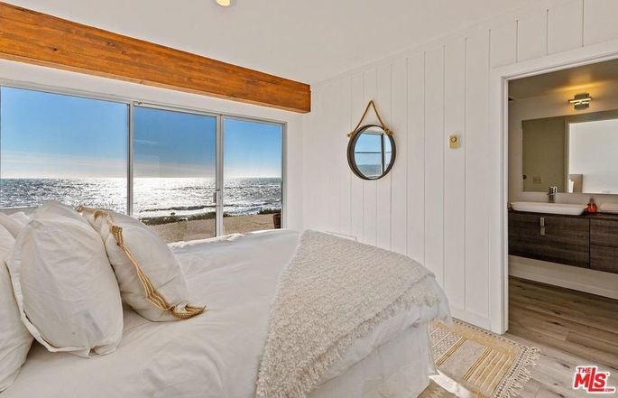 One of four bedrooms, with a private deck and bath